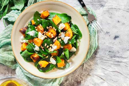Roasted pumpkin salad with spinach, feta and pine nuts