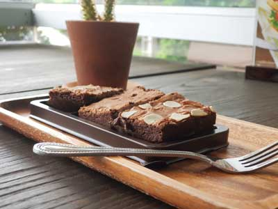 Dark chocolate brownies topping with almond slices